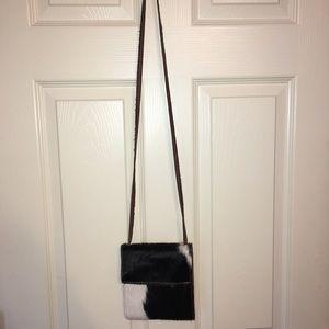 Cow hair on hide purse
